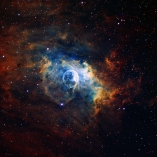The Bubble Nebula - An emission nebula in the constellation Cassiopeia. Blown by the wind from a massive star, the 10 light-year diameter bubble offers evidence of violent processes at work.