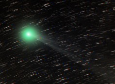 Comet Lemmon - glowing green from Cyanide in its coma.