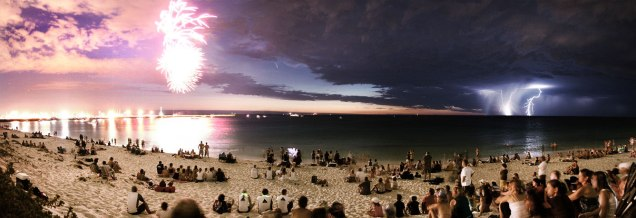 Comet McNaught Between Fireworks and Lightning in Perth