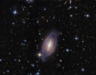 Polar Ring Galaxy - a rare type of galaxy with stars, gas and dust orbiting in rings perpendicular to the plane of a flat galactic disk.