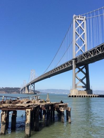 San Francisco Bay Bridge and old docks