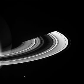 Saturn, its shadow and 4 of its moons