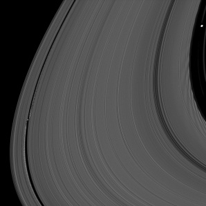 Saturn's moons Daphnis and Pan demonstrate their effects on the planet's rings
