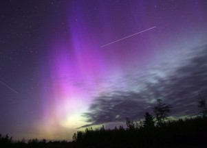 Purple aurora - The streak over center is caused by the International Space station. The streak on the right is an airplane. Taken June 6, 2013