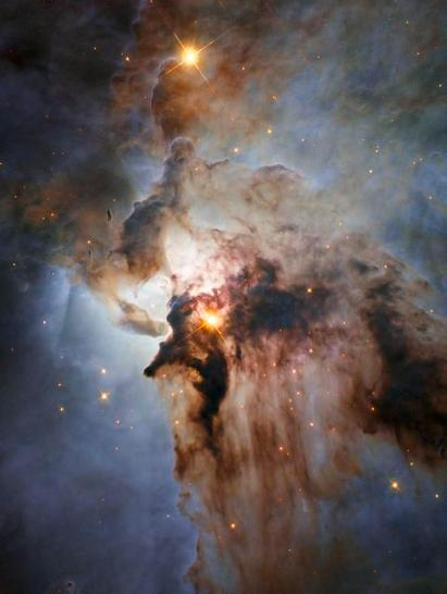 Center of the Lagoon Nebula filled with intense winds from hot stars, churning funnels of gas, and energetic star formation, all embedded within an intricate haze of gas and pitch-dark dust. Mo0re at https://www.flickr.com/photos/gsfc/20307734442/in/dateposted/