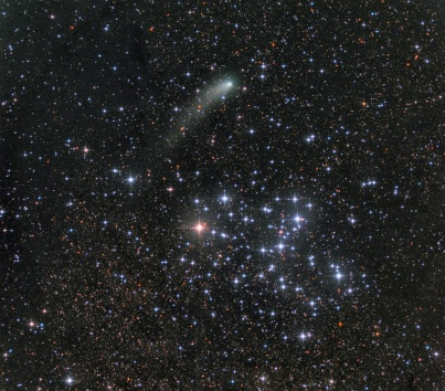 Comet and the Butterfly Star Cluster - more info at http://apod.nasa.gov/apod/ap141017.html