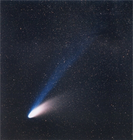 Comet Hale–Bopp from 1997. So bright it was visible to the naked eye for about 18 months.