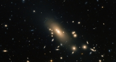 Galaxy Cluster Abell 1413 - over 300 galaxies - more info at http://www.nasa.gov/content/hubble-reveals-a-super-rich-galactic-neighborhood/#.VGYpQZDiaUk