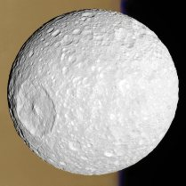 Mimas - Small Moon with a Big Crater - Whatever hit this moon of Saturn's nearly destroyed it. - More at http://apod.nasa.gov/apod/ap141021.html