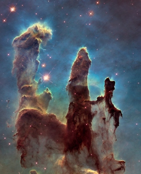 Pillars of Creation - Stars and solar systems being created here - more info at http://apod.nasa.gov/apod/ap150107.html