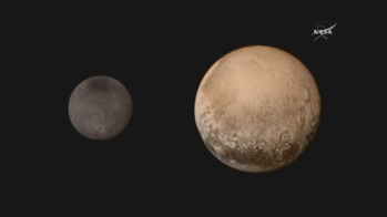 Pluto and one of its moons, Charon 7-13-2015