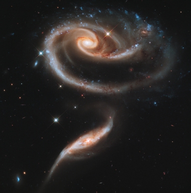 Rose of Galaxies (they look like they form a rose) - UGC 1810 and UGC 1813 - More info at http://hubblesite.org/newscenter/archive/releases/2011/11/image/a/