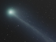 Comet SWAN and its ghostly tail. The color of the coma surrounding the head of the comet is tinged green by slight amounts of the molecule cyanogen. The blue color of the ion tail is dominated by carbon monoxide. Photo found on NASA's APOD http://apod.nasa.gov/apod/ap061106.html