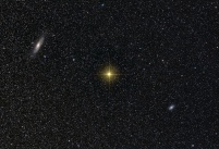 Two galaxies and lots of stars. We know the stars are in the foreground because they are from our galaxy.