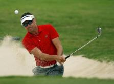 Robert Allenby of Australia hits out of the bunker on the 17th green during the third round of the Sony Open golf tournament at Waialae Country Club in Honolulu, Hawaii.